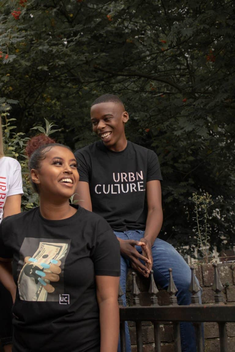 boy wearing black Urbnculture tee with pink and white urbnculture logo - with friends