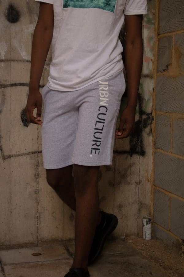 grey urbnculture shorts with text on side of left leg - half shot